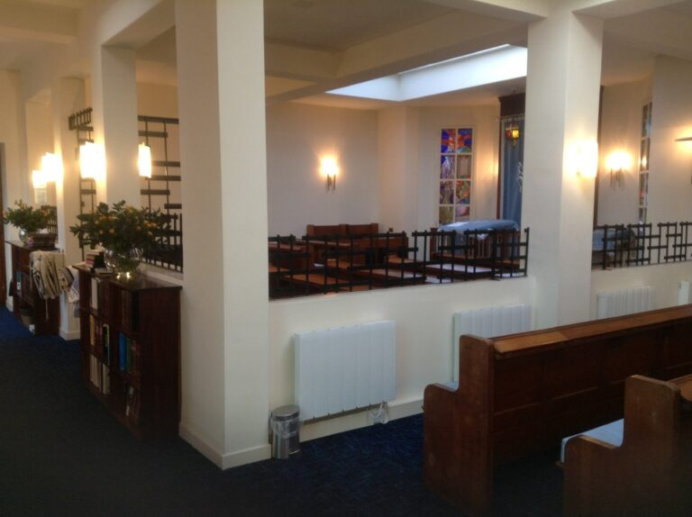 Photograph from the woman's section in the Beit Hamidrash onto the mens section